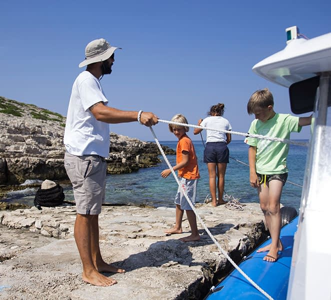Archipelago Tours Speedboat tours from Sibenik - About us photo of crew mooring the boat