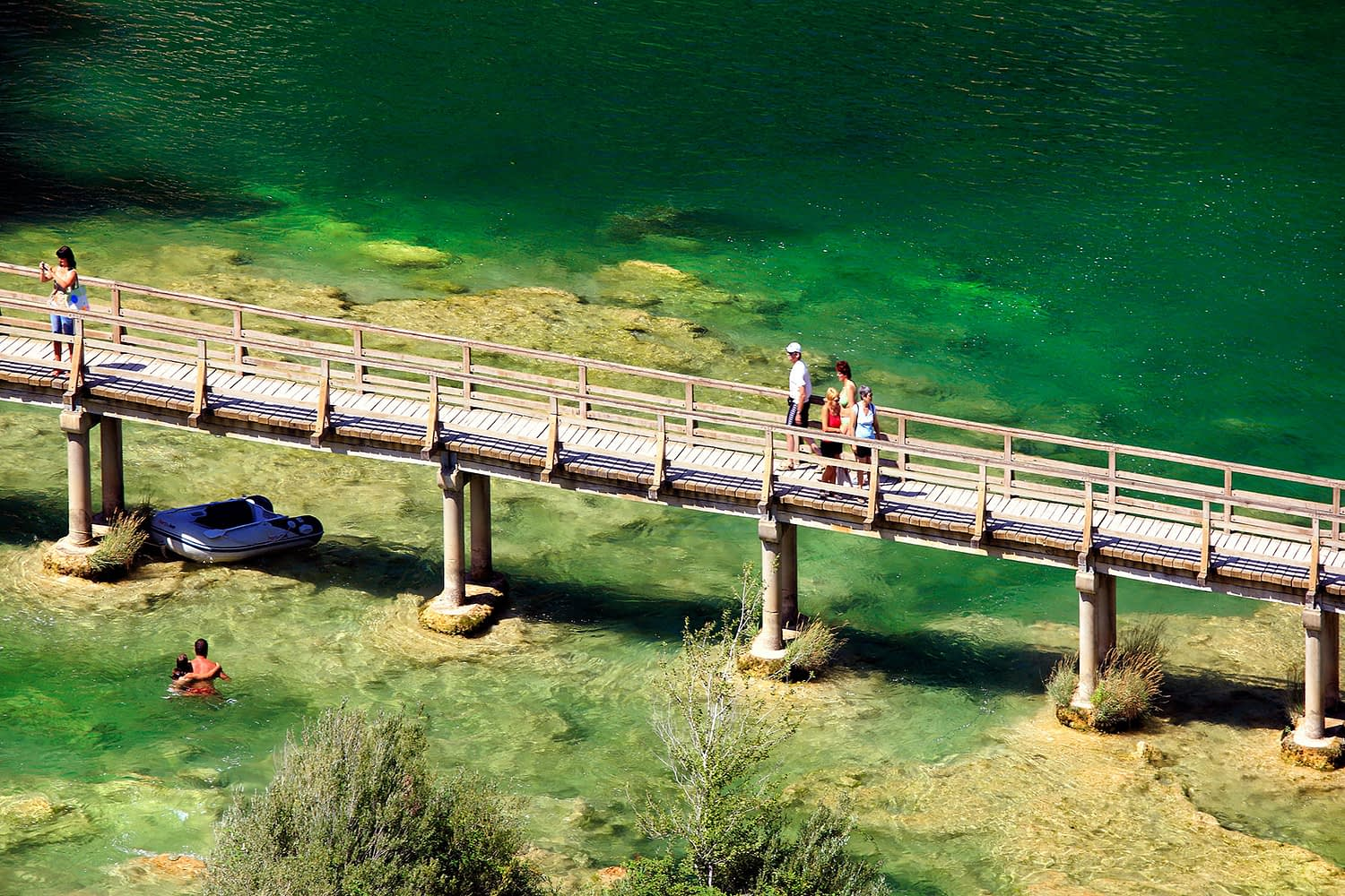 Archipelago Tours - Krka Experience Private Tour photo of tourists walking and swimming in Krka National Park