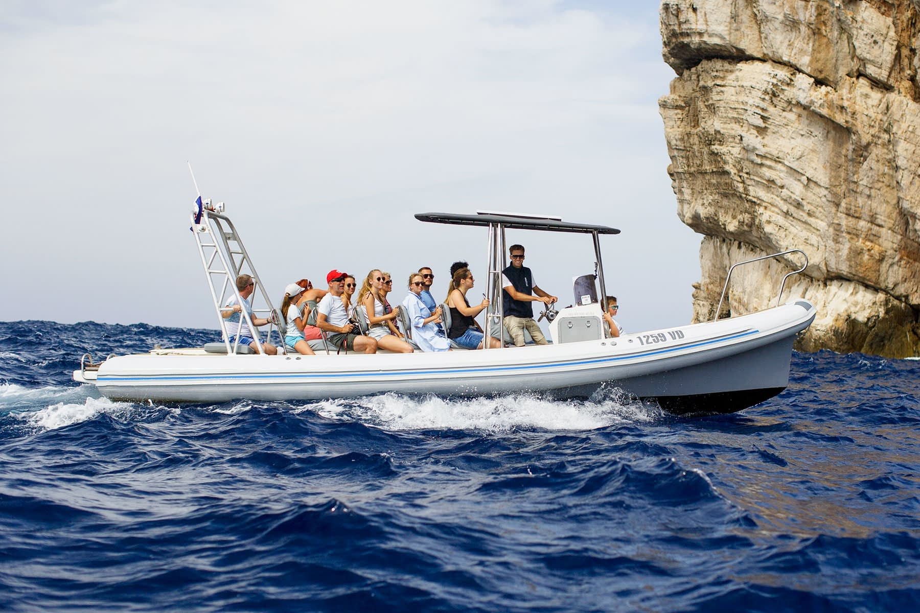 Archipelago Tours - Colnago boat photo taken under the cliffs in Kornati national Park