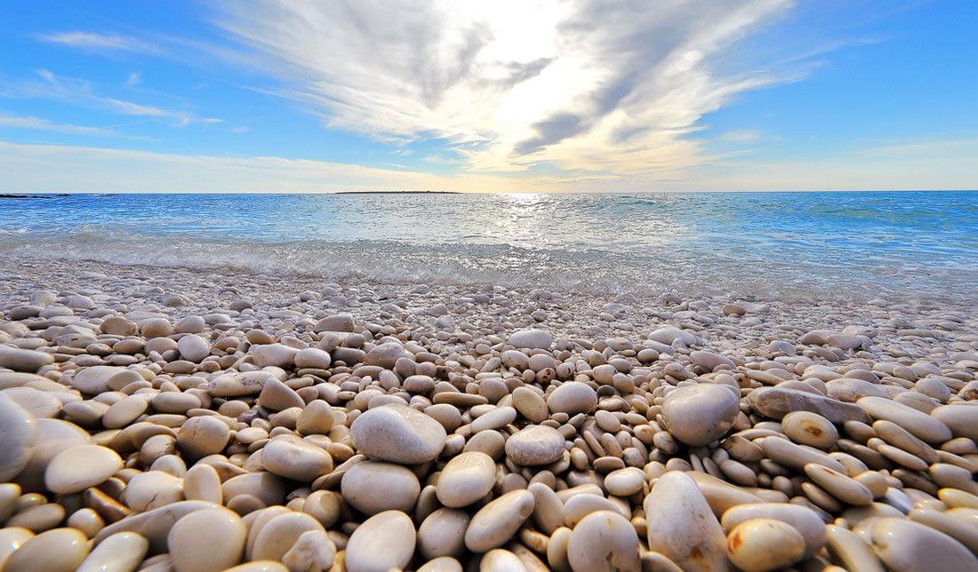 Archipelago Tours photo of beach pebbles. sea and blue sky