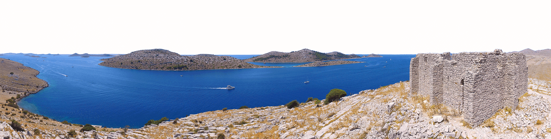 Archipelago Tours Croatia island boat tour - Kornati National Park panoramic photo with Tarac fortress in the foreground