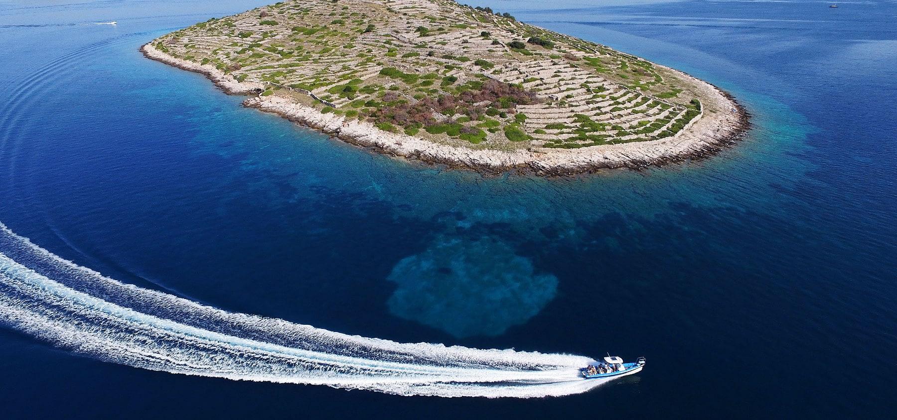 Archipelago Tours Croatia Sibenik boat tour - boat photo passing Bavljenac island from the air