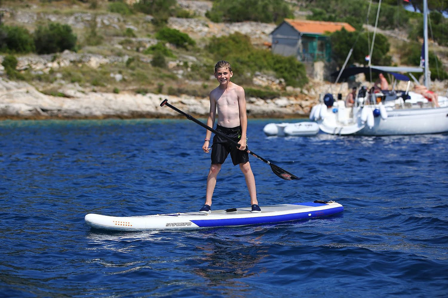 Archipelago Tours Kornati private tour - Kornati Experience Private Boat Tour photo of a child on a sup in Kornati national park